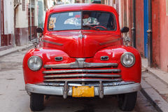 Vintage red car on the street of old city, Havana, Cuba Royalty Free Stock Image