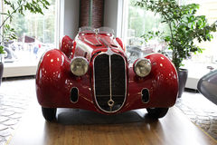 Vintage red car. View of the vintage red car indoor Royalty Free Stock Images