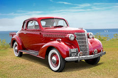 Vintage red chevrolet by coast Stock Photo