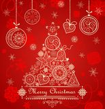 Vintage red christmas card with golden lacy conifer and hanging baubles Royalty Free Stock Images