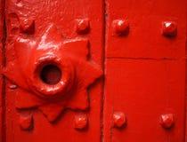 Vintage red door. A red door background close up Stock Photo