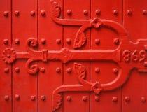 Vintage red door. A red door background close up Stock Image