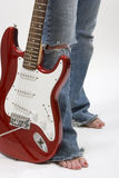 Vintage red electric solid body guitar, isolated on white. Royalty Free Stock Images