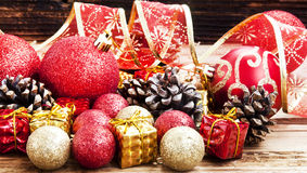 Vintage Red and Golden Christmas Glitter Globes and Decoration Stock Photo