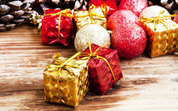 Vintage Red and Golden Christmas Glitter Globes and Decoration Stock Photos