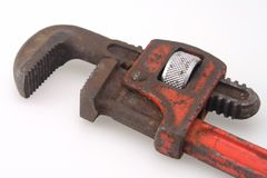 Vintage Red Handle Pipe Wrench. Old Vintage red handled plumbers pipe wrench stock image