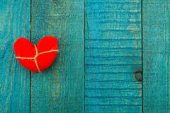 Vintage red heart blue wooden background Royalty Free Stock Photos