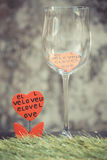 Vintage red hearts in Empty wine glass. Stock Image