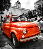 Vintage red italian car old selective color black and white italy 500 cinquecento. Vintage red italian car old selective color black and white italy town royalty free stock images