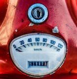 Vintage Red Italian Moped Speedometer. Retro Filtered Vintage Speedometer On Italian Moped Royalty Free Stock Photo