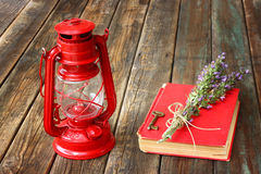 Vintage red lantern and red book on wooden table Royalty Free Stock Image