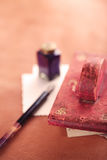 Vintage red leather ink blotter  with retro post cards on leathe Stock Photos