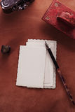 Vintage red leather ink blotter  with retro post cards on leathe Royalty Free Stock Image