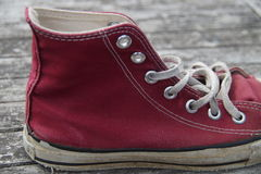 Vintage red (mahroon) canvas shoe - sneaker Royalty Free Stock Photo