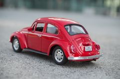 Vintage red miniature volkswagen bettle in the street. Mulhouse - France - 17 October 2018 - closeup of vintage red miniature volkswagen bettle in the street stock image