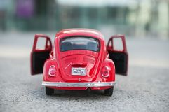 Vintage red miniature volkswagen bettle in the street. Mulhouse - France - 17 October 2018 - closeup of vintage red miniature volkswagen bettle in the street stock photos
