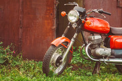 Vintage Red Motorcycle Generic Motorbike In Countryside Royalty Free Stock Photography