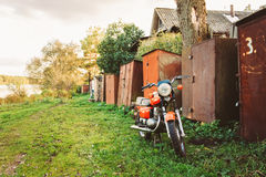 Vintage Red Motorcycle Generic Motorbike In Countryside Stock Photo