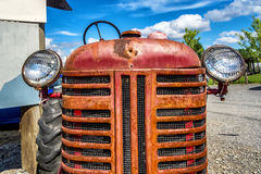 Vintage red Old Tractor front Stock Photo