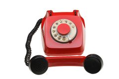 Vintage red phone isolated on a white background Royalty Free Stock Photo