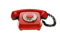 Vintage red phone isolated on a white background Royalty Free Stock Image