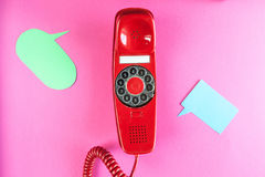 Vintage red phone and speech ballons stock image