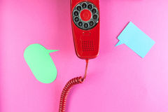 Vintage red phone and speech ballons stock photos