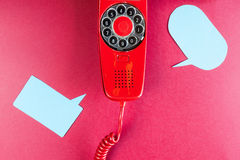 Vintage red phone and speech ballons royalty free stock photos