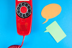 Vintage red phone and speech ballons royalty free stock photo