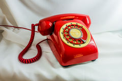 Vintage red phone. On white background Stock Photography
