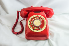 Vintage red phone. On white background Royalty Free Stock Photo