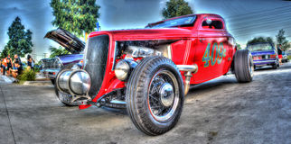 Vintage red race car. Customised red hot rod with race car motor on display Stock Photography