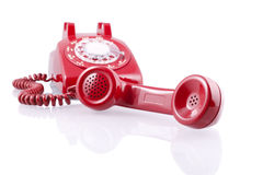 Vintage red rotary phone (with clipping path) Royalty Free Stock Image