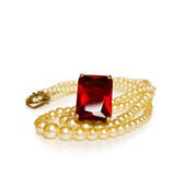 Vintage red ruby ring and pearls. Vintage jewelry with red ruby ring and string of pearls. Isolated on white background stock photography