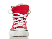Vintage red shoe closeup. On pure white background stock photography