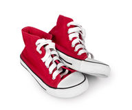 Vintage red sneakers isolated on white background. Vintage red sneakers isolated on white Royalty Free Stock Photos