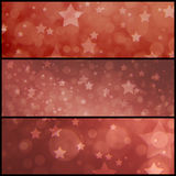 Vintage red star background, faded dull red with layers of stars and blurred bokeh lights. Matching graphic art side bars headers or footers of white stars and royalty free stock photo