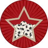 Vintage red star with soccer ball football over vintage star bur Stock Images