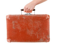 Vintage red suitcase in male hand Stock Photo