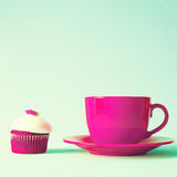Vintage red tea cup and cupcake Stock Image