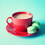 Vintage red tea cup and macaroons Royalty Free Stock Images