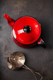 Vintage red teapot and mesh strainers Stock Photo
