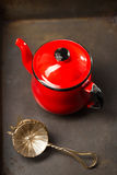 Vintage red teapot and mesh strainers Royalty Free Stock Photo