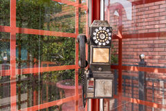 Vintage red telephone box. Vintage style image of typical red telephone box Royalty Free Stock Photos