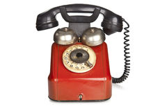 Vintage red telephone isolated on white background Stock Photo