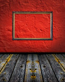Vintage red terracotta interior with classic frame. Vintage red terracotta interior with empty classic frame hanging on the wall concept dissonance Royalty Free Stock Images