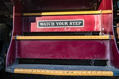 Watch your step sign on train royalty free stock photo