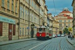 Vintage red tram on narrow street in Prague Stock Image