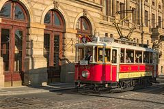 Vintage red tram at street in historical Center as symbol of Prague and Czech Republic Stock Photography