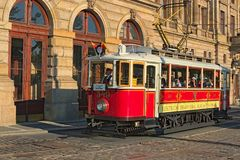 Vintage red tram at street in historical city center as symbol of Prague Stock Photo